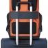 کوله-پشتی-دلسی-مدل-secuflap-نارنجی-202061025-نمای-نصب-شده-روی-ذسته-چمدان